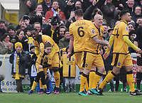 Football - 2016 / 2017 FA Cup - Fourth Round: Sutton United vs. Leeds United<br /> <br /> Jamie Collins - Sutton goalscorer , celebrates his goal with a young Masot and Roarie Deacon and Nicky Bailey (right) at Gander Green Lane.<br /> <br /> COLORSPORT/ANDREW COWIE