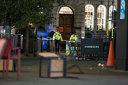 © Licensed to London News Pictures. 24/11/2017. London, UK. An abandoned chair at a police cordon on London's Carnaby Street as police deal with an incident at Oxford Circus. Photo credit: Rob Pinney/LNP