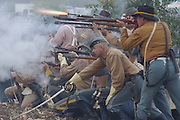 11/8/03 Moorepark CA--NEWS Civil War--Members of the Confederate Infantry return fire against the Union during a Civil War re-enactment at Tierra Rejada Ranch in Moorpark. photo by John McCoy/Daily News staff photographer.