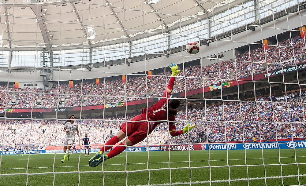 Goalkeeper Hope Solo of team USA dives and misses the ball for Japan's first goal en route to a 5-2 USA victory during 2015 women's World Cup Soccer in Vancouver during the final between USA and Japan.