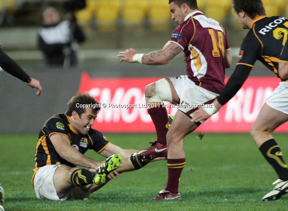 Southland's Kade Poki hands off Conrad Smith. ITM Cup rugby union - Wellington Lions v Southland Stags at Westpac Stadium, Wellington, New Zealand on Thursday, 18 August 2011. Photo: Dave Lintott / photosport.co.nz