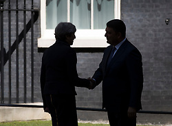 © Licensed to London News Pictures. 05/07/2017. London, UK. British Prime Minister Theresa May meets with Ukrainian Prime Minister Volodymyr Groysman in the shade of a summer's day in Downing Street. Photo credit: Peter Macdiarmid/LNP