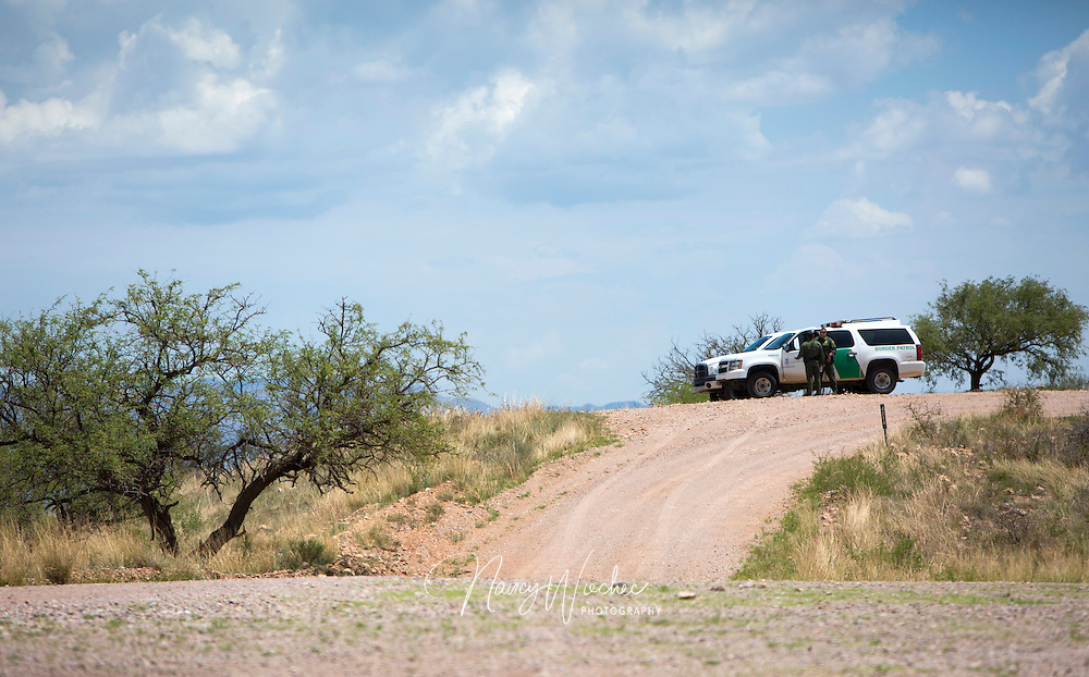 Agents from U.S. Border Patrol's Tucson Sector monitor an area west of Nogales, Ariz., July 16. Backcountry road creation and improvements made over the last several years have helped agents respond more quickly to reports of illegal crossings and emergency situations.   NANCY WIECHEC