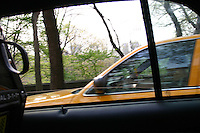 Travelling by taxi past Central Park, New York City