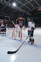 KELOWNA, CANADA, OCTOBER 5: Adam Brown #1 of the Kelowna Rockets welcomes the Pepsi player of the game against the Tri City Americans on October 5, 2011 at Prospera Place in Kelowna, British Columbia, Canada (Photo by Marissa Baecker/shootthebreeze.ca) *** Local Caption *** Adam Brown;
