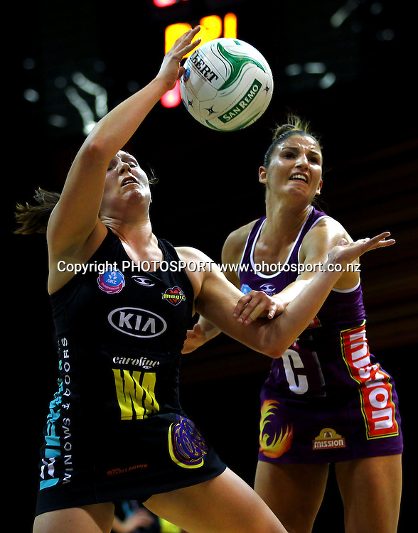 Magic's Khao Watts competes for the ball against Firebirds' Kimberley Ravaillion. ANZ Netball Championship, Minor Semifinal, Waikato/Bay of Plenty Magic v Queensland Firebirds, Claudelands Arena, Hamilton, New Zealand. Sunday 30th June 2013. Photo: Anthony Au-Yeung / photosport.co.nz