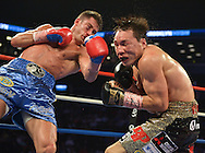 Chris Algieri(Blue trunks) strips Ruslan Provodnikov(Black/gold trunks) from his WBO junior welterweight title after defeating Provodnikov over a split decision at the Barclay's Center in Brooklyn, NY on Saturday June 14th, 2014.<br /> Algieri now 19-0 remains undefeated.