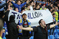 a small section of Cardiff fans stage a protest at end of match against the clubs owner and red shirts.   Barclays Premier league, Cardiff city v Hull city match at the Cardiff city Stadium in Cardiff, South Wales on Saturday 22nd Feb 2014.<br /> pic by Andrew Orchard, Andrew Orchard sports photography.