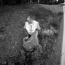 Kyle Green / The Roanoke Times<br /> 7/27/2012 Bedford County inmate Kevin Goode picks up trash on the side of Goodview road in Blue Ridge, Virginia. Bedford County recently launched a new Inmate Work Force Program, which uses low-risk inmates to pick up trash along the roads of Bedford County. The inmates volunteer and must qualify to participate. Only non-violent offenders and non-felons are allowed to participate. &quot;I'm blessed to have it (the work)&quot; said Kevin. &quot;I can't get a job, but maybe someone will see me out here and give me a job&quot;.