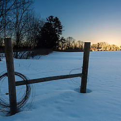 Sunrise over a snow-covered field in Epping, New Hampshire.