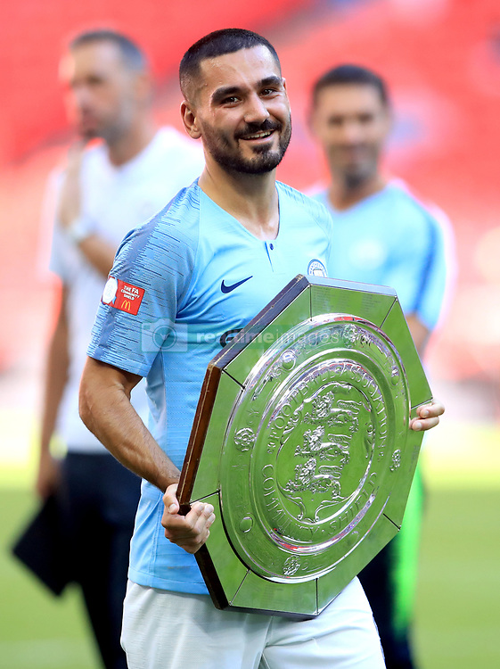Manchester City's Ilkay Gundogan celebrates with the Community Shield after winning the Community Shield match at Wembley Stadium, London.