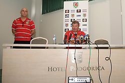 PODGORICA, MONTENEGRO - Tuesday, August 11, 2009: Wales' manager John Toshack MBE and press officer Ceri Stennett during a press conference at the Podgorica Hotel ahead of the international friendly match against Montenegro. (Photo by David Rawcliffe/Propaganda)