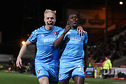 Alex Addai celebrates his goal with Ryan Broom during the The FA Cup match between Swindon Town and Cheltenham Town at the County Ground, Swindon, England on 19 November 2019.