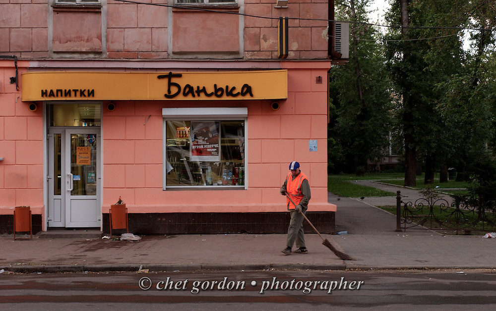 A worker sweeps a street at dawn in Irkutsk, Russian Federation on June, 16, 2005.