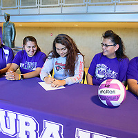 Miyamura Patriot Mikayla Livingston, center, will sign to play with  Southeastern College in West Burlington, Iowa. Livingston is surround by varsity volleyball coach David Scott, older sister, Michelle Livingston, mother Jeanise Livingston and father Michael Livingston at Miyamura High School in Gallup Thursday.
