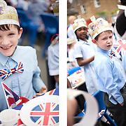 Children celebrate the Diamond Jubilee at Corpus Christi Catholic School. London 1st June 2012