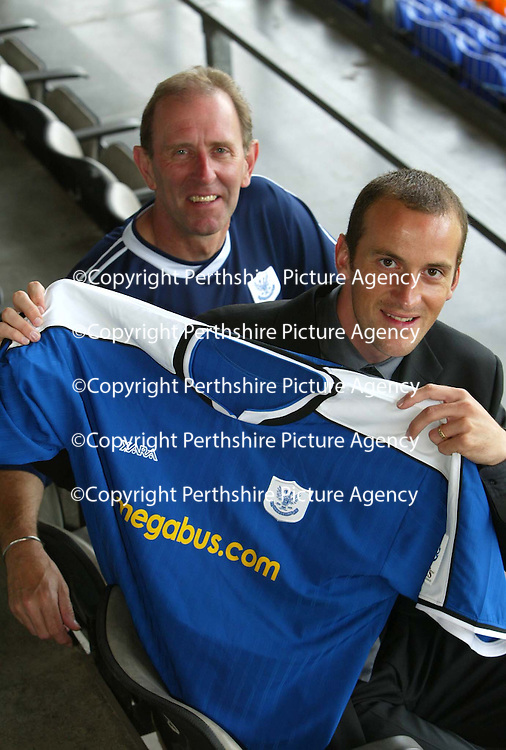 Paul Sheerin pictured at McDiarmid Park with John Connolly after signing a two year deal to join St Johnstone from Aberdeen.<br />see story by Gordon Bannerman Tel: 01738 553978 or 07729 865788<br />Picture by Graeme Hart.<br />Copyright Perthshire Picture Agency<br />Tel: 01738 623350  Mobile: 07990 594431