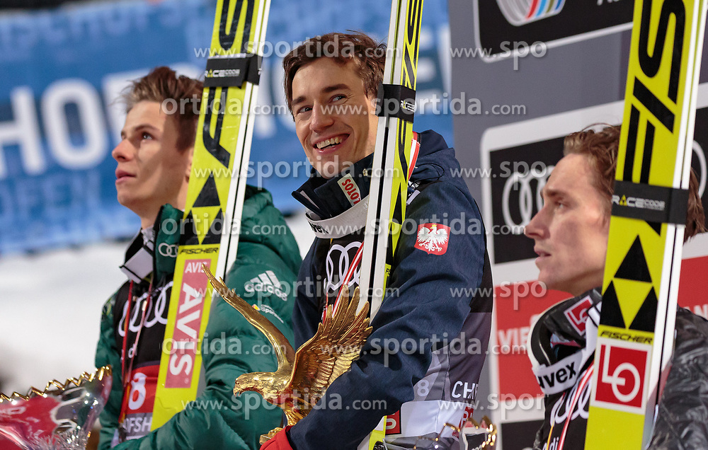06.01.2018, Paul Außerleitner Schanze, Bischofshofen, AUT, FIS Weltcup Ski Sprung, Vierschanzentournee, Bischofshofen, Siegerehrung, im Bild im Bild v. l.: 2. Platz Andreas Wellinger (GER), 1. Platz Kamil Stoch (POL), 3. Platz Anders Fannemel (NOR) // 2nd placed Andreas Wellinger of Germany Winner Kamil Stoch of Poland 3nd placed Anders Fannemel of Norway during the Winner Award Ceremony of the Four Hills Tournament of FIS Ski Jumping World Cup at the Paul Außerleitner Schanze in Bischofshofen, Austria on 2018/01/06. EXPA Pictures © 2018, PhotoCredit: EXPA/ Stefanie Oberhauser