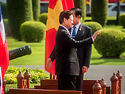 23 JULY 2015 - BANGKOK, THAILAND: NGUYEN TAN DUNG (left), waves to the honor guard after the welcoming ceremony for the Vietnamese Prime Minister. The Vietnamese Prime Minister and his wife came to Bangkok for the 3rd Thailand - Vietnam Joint Cabinet Retreat. The Thai and Vietnamese Prime Minister discussed issues of mutual interest.      PHOTO BY JACK KURTZ