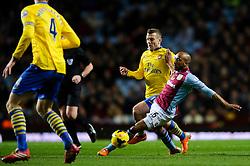 Aston Villa Midfielder Fabian Delph (ENG) is tackled by Arsenal Midfielder Jack Wilshere (ENG) during the first half of the match - Photo mandatory by-line: Rogan Thomson/JMP - Tel: Mobile: 07966 386802 - 13/01/2014 - SPORT - FOOTBALL - Villa Park, Birmingham - Aston Villa v Arsenal  - Barclays Premier League.