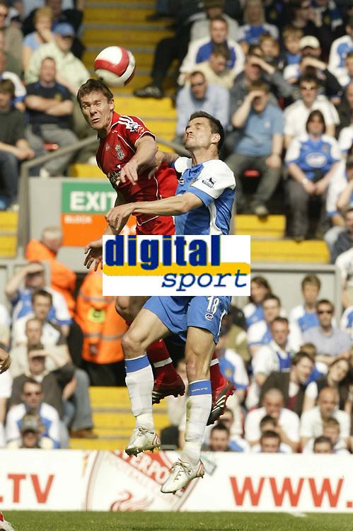 Photo: Aidan Ellis.<br /> Liverpool v Wigan Athletic. The Barclays Premiership. 21/04/2007.<br /> Liverpool's Daniel Agger beats Wigan's Paul Scharner to the ball