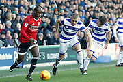 Fulham striker Sone Aluko (24) gets past Queens Park Rangers defender Jake Bidwell (3) during the EFL Sky Bet Championship match between Queens Park Rangers and Fulham at the Loftus Road Stadium, London, England on 21 January 2017. Photo by Andy Walter.