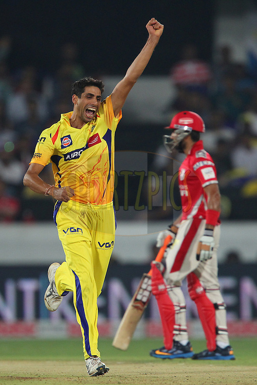 Ashish NEHRA of the Chennai Superkings celebrates the wicket of Glenn MAXWELL of the Kings XI Punjab  during the second semi final match of the Oppo Champions League Twenty20 between the Kings XI Punjab and the Chennai Superkings held at the Rajiv Gandhi Cricket Stadium, Hyderabad, India on the 2nd October 2014<br /> <br /> Photo by:  Ron Gaunt / Sportzpics/ CLT20<br /> <br /> <br /> Image use is subject to the terms and conditions as laid out by the BCCI/ CLT20.  The terms and conditions can be downloaded here:<br /> <br /> http://sportzpics.photoshelter.com/gallery/CLT20-Image-Terms-and-Conditions-2014/G0000IfNJn535VPU/C0000QhhKadWcjYs
