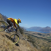 Tony Boroviec from Christchurch in action during the New Zealand South Island Downhill Cup Mountain Bike series held on The Remarkables face with a stunning backdrop of the Wakatipu Basin. 150 riders took part in the two day event. Queenstown, Otago, New Zealand. 9th January 2012. Photo Tim Clayton