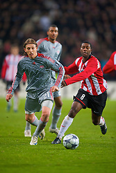 EINDHOVEN, THE NETHERLANDS - Tuesday, December 9, 2008: Liverpool's Lucas Leiva and PSV Eindhoven's Edison Mendez during the final UEFA Champions League Group D match at the Philips Stadium. (Photo by David Rawcliffe/Propaganda)