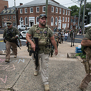 "CHARLOTTESVILLE,VA-AUG12: A group calling themselves The Militia, arrive to ""keep the peace"" outside the Unite the Right rally in Charlottesville,Virginia, August 12, 2017.(Photo by Evelyn Hockstein/For The Washington Post)"