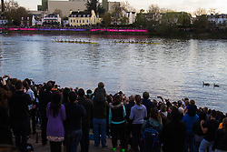 London, April 2nd 2017. The winners celebrate and the losers commiserate at the finish of the 163rd running, and 72nd for women, of the Cancer Research UK Boat Race between Oxford and Cambridge Universities on the River Thames between Putney Bridge and Chiswick Bridge.