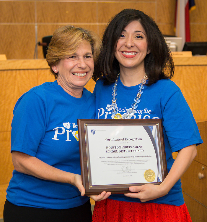 American Federation of Teachers president Randi Weingarten, left, presents Houston ISD board of trustees president Juliet Stipeche, right, with a certifcate of recognition for the District's employee anti-bullying policy, September 12, 2014.