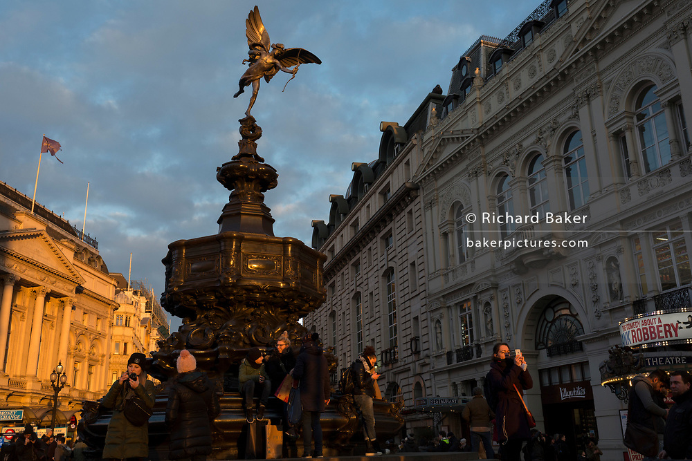 "Winter sunshine on the Eros statue landmark in Piccadilly Circus, on 6th February 2018, in London, England. The Shaftesbury Memorial Fountain is located at the southeastern side of Piccadilly Circus in London, United Kingdom. Moved after World War II from its original position in the centre, it was erected in 1892–1893 to commemorate the philanthropic works of Lord Shaftesbury, who was a famous Victorian politician and philanthropist. The monument is surmounted by Alfred Gilbert's winged nude statue generally, though mistakenly, known as Eros. This has been called ""London's most famous work of sculpture."""