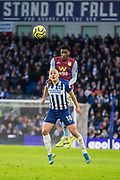 Aaron Mooy (Brighton) & Kortney Hause (Aston Villa) heading the ball during the Premier League match between Brighton and Hove Albion and Aston Villa at the American Express Community Stadium, Brighton and Hove, England on 18 January 2020.