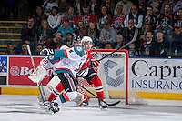 KELOWNA, CANADA - APRIL 19: Madison Bowey #4 of the Kelowna Rockets skates for the puck against the Portland Winterhawks on April 18, 2014 during Game 2 of the third round of WHL Playoffs at Prospera Place in Kelowna, British Columbia, Canada.   (Photo by Marissa Baecker/Shoot the Breeze)  *** Local Caption *** Madison Bowey;