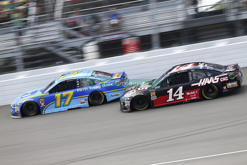 August 12, 2018 - Brooklyn, Michigan, United States of America - Ricky Stenhouse, Jr (17) and Clint Bowyer (14) battle for position during the Consumers Energy 400 at Michigan International Speedway in Brooklyn, Michigan. (Credit Image: © Chris Owens Asp Inc/ASP via ZUMA Wire)