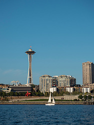United States, Washington, Seattle, Space Needle and sailboat, viewed from boat in Elliott Bay of Puget Sound