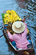 Woman selling bananas at a floating market, Damnoen Saduak,Thailand.