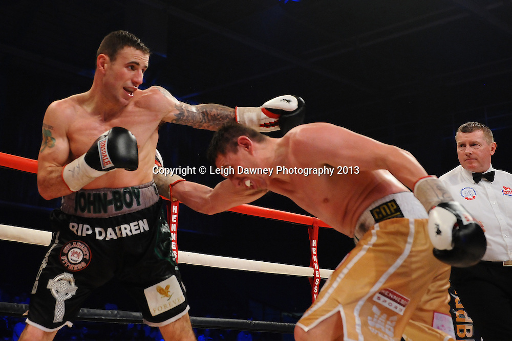 Peter McDonagh (gold shorts) defeats John Hutchinson to claim the Vacant Irish Light Middleweight Title on 15th March 2014 at the Rivermead Leisure Centre, Reading, Berkshire. Promoted by Hennessy Sports. © Leigh Dawney Photography 2014.