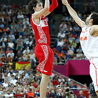 10 August 2012: Russia Alexey Shved takes a three points jumpshot during 67-59 Team Spain victory over Team Russia, during the men's basketball semi-finals, at the North Greenwich Arena, in London, Great Britain.
