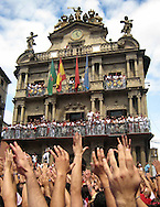 "People celebrate the ""Chupinazo"", the fireworks with whose explosion the San Fermin festivities start, in front of the Pamplona Town Hall, on July 6, 2008, in Pamplona, north of Spain. Bullfighting and the spectacular Run of the Bulls are the main ingredients of these San Fermin Festivities that end on July 14. A man jumps from the Navarreria fountain to fall on the crowd celebrating the ""Chupinazo"", the fireworks with whose explosion the San Fermin festivities start, on July 6, 2008, in Pamplona, north of Spain."