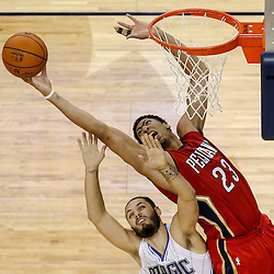 Oct 28, 2014; New Orleans, LA, USA; New Orleans Pelicans forward Anthony Davis (23) rebounds over Orlando Magic guard Evan Fournier (10) during the fourth quarter of a game at the Smoothie King Center. The Pelicans defeated the Magic 101-84. Mandatory Credit: Derick E. Hingle-USA TODAY Sports