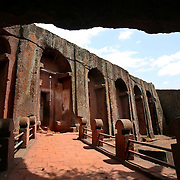 The Bet Gabriel-Rafael church in Lalibela. Lalibela's churches are in carved out of red volcanic stone. Bet Gebriel-Rafael has a plunging facade. Christianity came to Ethiopia in the 4th century and the Ethiopian Orthodox Church has retained its own unique traditions.