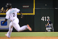 PHOENIX, AZ - JULY 05:  Alex Dickerson #1 of the San Diego Padres makes the throw over teammate Travis Jankowski #16 as Jean Segura #2 of the Arizona Diamondbacks rounds second base for a triple in the fifth inning at Chase Field on July 5, 2016 in Phoenix, Arizona.  (Photo by Jennifer Stewart/Getty Images)