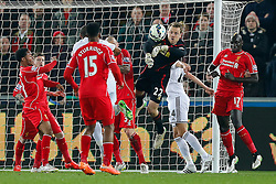 Simon Mignolet of Liverpool punches clear - Photo mandatory by-line: Rogan Thomson/JMP - 07966 386802 - 16/03/2015 - SPORT - FOOTBALL - Swansea, Wales — Liberty Stadium - Swansea City v Liverpool - Barclays Premier League.