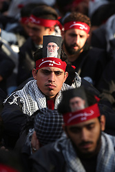 Hezbollah (or Hezbollah) militants and supporters (with a photo of Iran Supreme Guide Khamenei) gather to mark 'Ashura' celebration in the southern suburb of Beirut, Lebanon, on October 12, 2016. Ashura (or Achoura) is the 10th day of the day of Muharram in the Islamic calendar. For shiite Muslims, it marks the death of Hussein ibn Ali, the grandson of Propher Muhammad at the Battle of Karbala in 680. Photo by Balkis Press/ABACAPRESS.COM