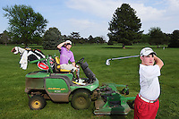 Brothers Luke (on mower) and Ben Grossnicklaus pose for a portrait at Aurora Country Club. The golfers will be competing in the state tournament and also run a mowing business. (Independent/Matt Dixon)