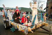 "The Santa Fund ""Frozen"" float heads down Main Street during the annual holiday parade with a stop in Veteran's Square for the tree lighting ceremony on Sunday evening.  (Karen Bobotas/for the Laconia Daily Sun)"