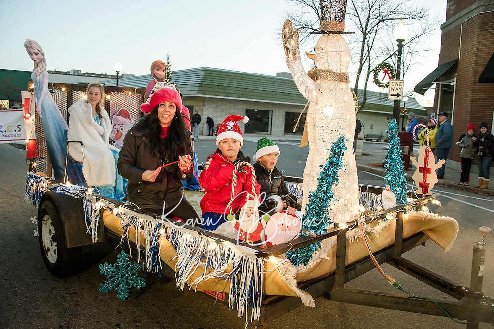 """The Santa Fund """"Frozen"""" float heads down Main Street during the annual holiday parade with a stop in Veteran's Square for the tree lighting ceremony on Sunday evening.  (Karen Bobotas/for the Laconia Daily Sun)"""