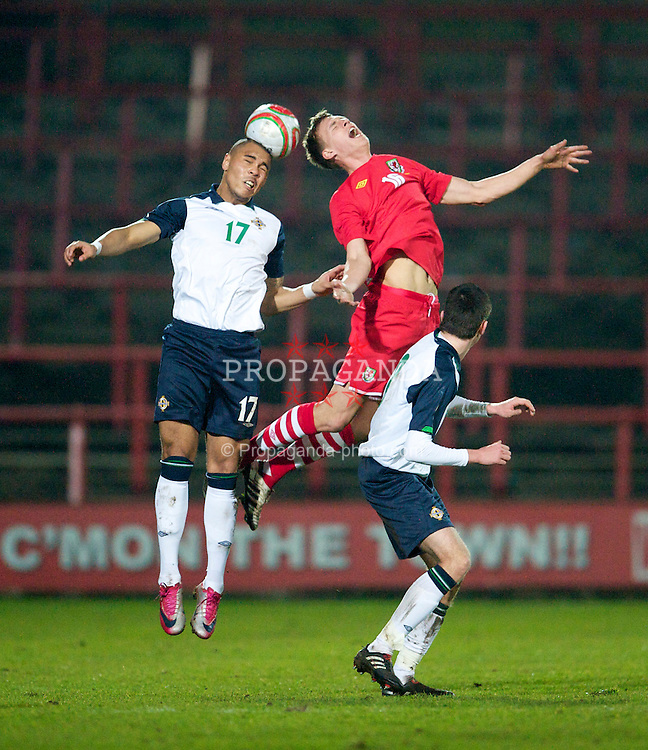 WREXHAM, WALES - Wednesday, February 9, 2011: Wales' Elliott Chamberlain and Northern Ireland's Josh Magennis during the Under-21 International Friendly match at the Racecourse Ground. (Photo by David Rawcliffe/Propaganda)